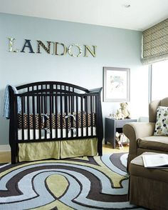 Personalized Nursery - splash around some bright colors. Robin's-egg blue walls against crisp white trim establish a strong, simple background, while plush carpet with large pattern loops creates a playful contrast. The same bold colors make an appearance on the whimsical wall letters.