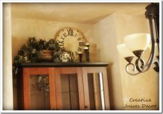 Decorating the top of your Kitchen Cabinets - a few Tips and Tricks ... For above my entertainment center!