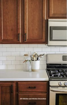 A kitchen remodel with wood cabinets and white countertops. This kitchen makevoe… A kitchen remodel with wood cabinets and white countertops. This kitchen makevoer reveal has the cutest kitchen decor ideas! Outdoor Kitchen Countertops, White Countertops, New Kitchen Cabinets, Wood Cabinets, Island Kitchen, White Cabinets, Maple Cabinets, Kitchen Sinks, Dark Cabinet Kitchen