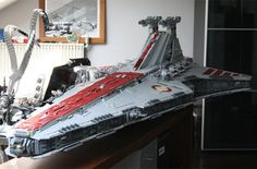 This is an 8-foot, 180-lb Venerator Class Star Destroyer made entirely out of 43,000 LEGO pieces by LEGO-maniac Iomedes. It...would look great in my bedroom. And by bedroom I mean my actual bed because there's noway in hell it....