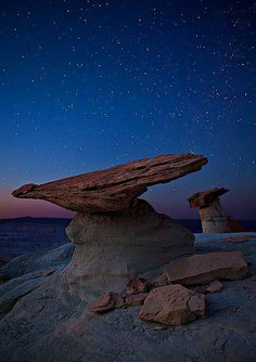 Symmetrical hoodoos at Stud Horse Point under a starry sky near Page, Arizona.