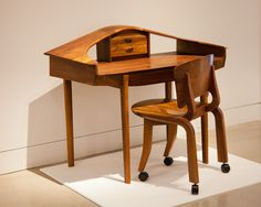 """James Henkle Desk, 1990 Walnut and Olive 36"""" x 42"""" x 21""""  On loan from private collection  James Henkle Desk Chair, 1990 Walnut 30.5"""" x 21.5"""" x 19.5"""" On loan from private collection"""