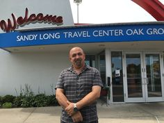 Sam Tahour, district manager for Travel Centers of America, stands next to a travel plaza in Oak Grove, Mo. Tahour was trained as part of a new effort to identify and stop sex trafficking at truck stops.