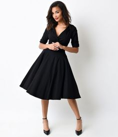 Let Delores get domestic with you, darling. A bewitching black frock rich in 1950s vintage dress appeal fresh from Uniqu...Price - $88.00-Lo2454vn