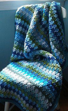 Ravelry: lyndamk's Oceana Larksfoot blanket. Free crochet pattern (video and diagram!) I love the watery colors in this.