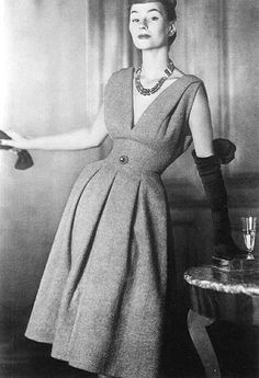 Anne Gunning is wearing a gray wool day dress by Christian Dior, 1950