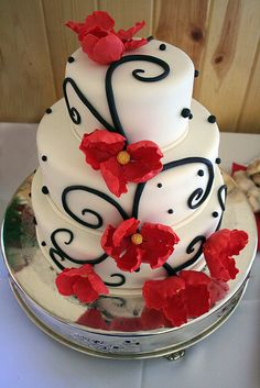 Red, black, and white decorated cake...