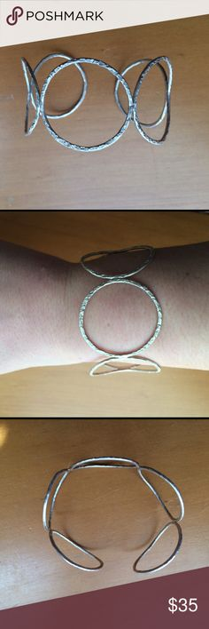 Sterling silver design cuff This cuff is beautiful just doesn't get worn! Sterling silver and is a cuff so slips right on. Jewelry Bracelets