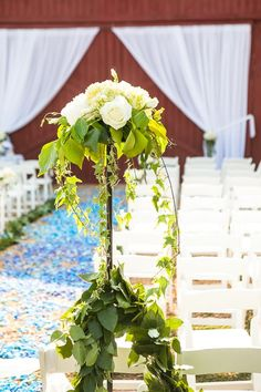 pretty topiaries for aisle entrance