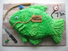 Carved fish cake iced with buttercream and foundant decorations.  Got...