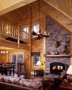 The livingroom of the Field and Stream Dream Cabin at Sterling Ridge Resort - Jeffersonville, VT