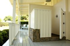 incorporate some lava rock with farm dwelling exterior siding for outdoor shower - this one is TOO closed, however
