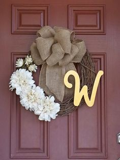 DIY Family Initial Wreath!  Burlap bow, painted wooden initial and flowers. A nice way to greet your visitors when they come to your front door!