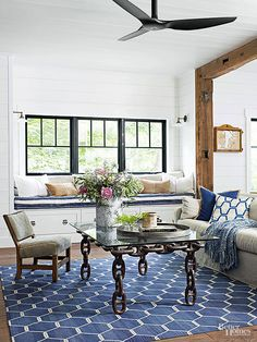 Cool blues and nautical themes imbue this living room with lakefront authenticity. The coffee table is made from anchors, while the royal blue rug repeats the watery motif. Old beams frame the doorway, and ebony window trim frames the outdoor views. Living Room Designs, Living Room Decor, Living Rooms, Family Rooms, Living Spaces, Room Inspiration, House Design, Decor Ideas, Decorating Ideas