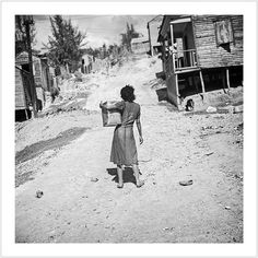 Girl carrying water in gasoline can, (Ponce, Puerto Rico). (Edwin Rosskam, 1938)
