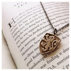 Gryffindor Crest Pendant ($25) ❤ liked on Polyvore featuring jewelry, backgrounds, harry potter, necklaces, heart shaped pendant, steel pendant, heart pendant, steel jewelry and heart pendant jewelry