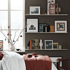 Picture ledge in the bedroom. Lovely and simple way to display cherished photos and items.