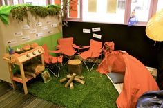 Bring in some folding chairs to set up near fake fire and tent.  I also like the fake grass.