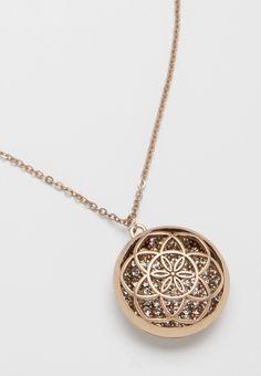 goldtone pendant necklace with shimmering rhinestone interior