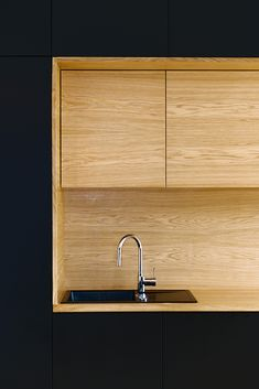 "Black Line Apartment / Arhitektura d.o.o.  ""Love the contrast of warm oak and black matt lacquer doors"""