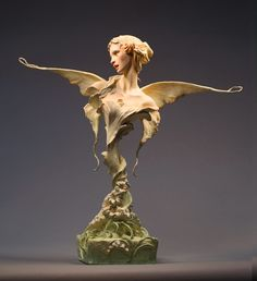 Flora, La Primavera, in Premier air-dry clay, with wood, and paper, painted in acrylic by FOREST ROGERS