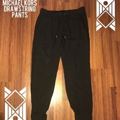 Michael Kors Drawstring Pants Very comfortable drawstring pants from Michael Kors. Stretchy elastic bands at waist and ankles with gold accessories. Also has 2 pockets in back. Size 6. 100% Rayon...definitely pants to wear when you don't want to worry about what to wear!  Michael Kors Pants