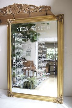 Wedding seating chart on antique gold mirror. Alphabetical escort mirror. Elegant wedding style. Handpainted and personalized. Initial Monogram