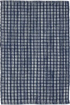 Inspired by a colorful knit throw, this indoor/outdoor area rug features a unique texture and mottled, knitted look produced by a mix of poly yarns that peek through from under a blue checkerboard pattern. Use it to create a cozy feel in high-traffic areas, without having to worry about cleanup!