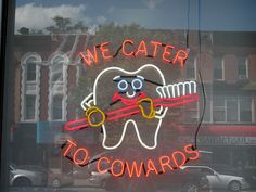 'We Cater To Cowards' Neon sign of a Dental Group in Sunset Park, Brooklyn via Flickr