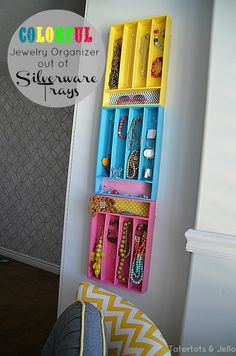 I love this  great idea  maybe the dollar store has these for cheap.  Silverware Tray Jewelry Organizers , simple and colorful