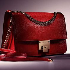 "3dcc27d5affc ""The  JimmyChoo REBEL shoulder bag takes on a shade of vibrant red for the"