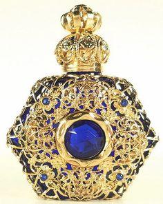 Rare vanity gold toned jeweled perfume bottle