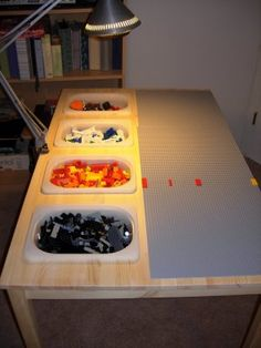 Lego Table.   {We did this with an old kitchen table and bins from Target dollar spot. Very easy DIY and the boy uses it every day!}