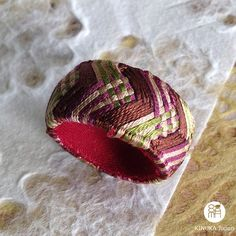Item: A ring  Kaga Yubinuki is a traditional Japanese ring shaped thimble made with Japanese silk threads and paper. As its made of silk and paper, it is so lightweight but please be careful not to let it wet. If it gets wet, dry it in shade. ;)  if you are allergic to metal, this Yubinuki ring is for you!  We are sure that our original colour combination will be an unusual gift!  ++++++++++++++++++++++++++++++++++++++++++++++++++++++++++ About Size  internal diameter: approx. 17mm external…