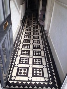 The photographs below are from a Victorian tiled hallway floor at a property in Stoke Newington in London. The floor was in need of repair with a large area very uneven and partly sunk in the middle of the pattern. The repairs were made using as many existing tiles as possible.