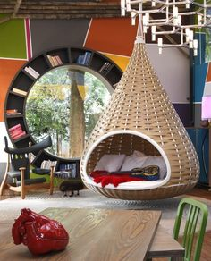 """A nondescript house was renovated to create """"Cabana Urbana"""", a vibrant weekend retreat in São Paulo, Brazil with a 914 sq ft studio pl. Cabana Urbana, Shabby Chic Zimmer, Hanging Beds, Hanging Chairs, Hanging Basket, Diy Hanging, Indoor Swing, Indoor Hammock, Bookshelf Design"""