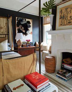 How black can work in a room. interiors — W i l l i a m . M c L u r e bedroom fireplace gallery wall blue dark