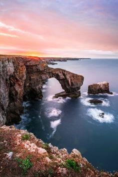 Sunrise, The Green Bridge of Wales, Natural Sea Arch, Castlemartin, Pembrokeshire, Wales by Joe Daniel Price**