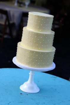 Grey cake, yellow dots / By Sweet and Saucy / Via http://www.sweetandsaucyshop.com/gallery/wedding-cakes-gallery/