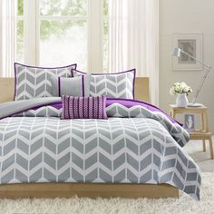 Peyton makes any bedroom fun and inviting. The duvet cover features a fresh solid purple color with a gray and white chevron print that runs along the bottom broken up by white vertical stripes.