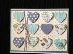 Embossing a background and using 12 small hearts to make a big statement!
