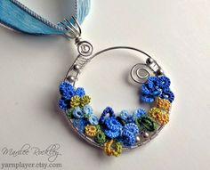 Wire wrapped argentium silver pendant with tatting mixed media jewelry