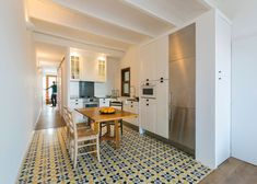 Barcelona apartment renovation by Nook with tiles and window seat - love the blend of parquet floor and tiles