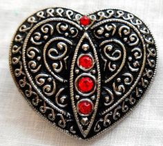This is for one large Czech glass black, silver and red decorative heart shaped shank button. It measures 32mm from top to bottom by 35mm from side to side at the widest points. It would make a great
