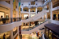 The Best Shopping Malls in Montreal: Above: inside one of Montreal's shopping malls, the Cours Mont Royal, a downtown shopping destination filled with luxury boutiques.