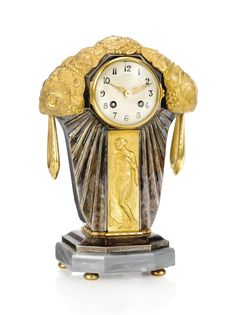 AN ART DECO GILT-BRONZE AND SILVERED-BRONZE MANTEL CLOCK BY FARGETTE -  CIRCA 1930
