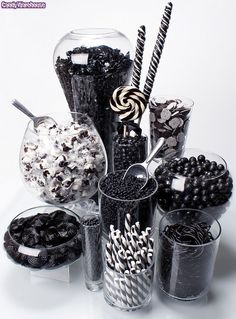 Add various glasses to the jam jars for teh candy buffet. Black Candy Buffet by candywarehouse, via Flickr