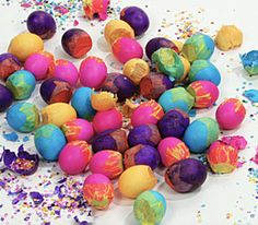 Cascarones are brightly colored confetti-filled eggs. Cascarones may be used to decorate centerpieces, wreaths, or party table tops.