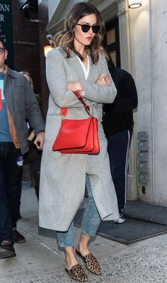 Mandy Moore in a gray coat, red bag, jeans and leopard flats - click through for more spring outfit ideas