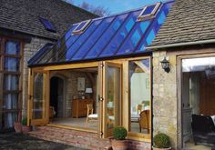 Oak conservatory with opening vents and bi-folding doors